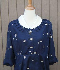 Vintage Herbert Levy 1940s Navy Dress. $39.00, via Etsy.