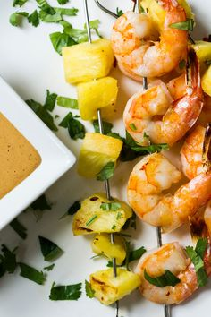 NYT Cooking: This tangy version of Thai peanut sauce, bright with chile, lime, and ginger, is excellent with chicken and beef — and outstanding with shrimp. <br /><br />Here, the sauce is paired with sweet, juicy pineapple and succulent shrimp, which broil in minutes. It's a quick, satisfying dinner with the added bonus of leftover peanut sauce, which will keep well in the fridge for...