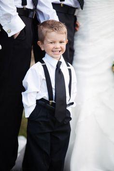 sweet little ring bearer in suspenders.