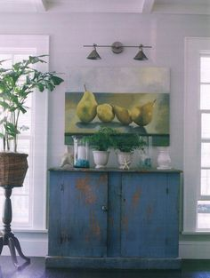 Molly Frey Design, antique blue hutch, double sconce, fruit painting, coastal interiors