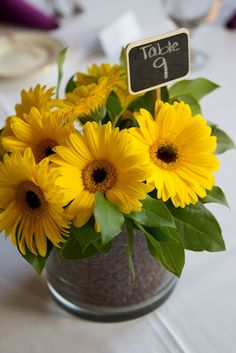 {Yellow Gerbera Daisy Centerpiece with Coffee Bean Detail} These were the centerpieces at our #brunch wedding reception.