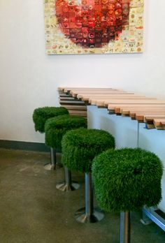 X The Market 3rd Street Promenade Artificial Grass Stools in a row
