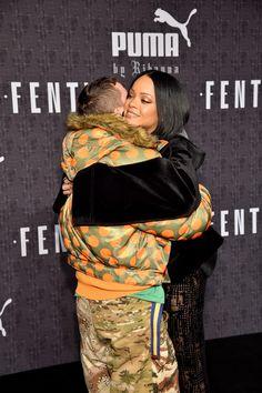 Rihanna Photos Photos - Fashion designer Jeremy Scott and Rihanna attend the FENTY PUMA by Rihanna AW16 Collection during Fall 2016 New York Fashion Week at 23 Wall Street on February 12, 2016 in New York City. - FENTY PUMA by Rihanna AW16 Collection - Arrivals - Fall 2016 New York Fashion Week