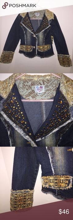 Unique Gorgeous Detailed Denim Jacket Sz 5 Amazing Unique Gorgeous Detailed Denim Jacket Sz 5 Amazing! Distressed denim Jean jacket featuring lace. 2 buttons in front with rhinestones in the middle of button. Heart Studs on collar flap with lace detailed color. 2 Faux pockets in front lace details. See pictures!!! Very unique one of a Kind designer jacket. Size 5. Worn very few times.  Beautiful Girl Boutique Jackets & Coats Jean Jackets