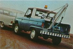 Classic early ford bronco tow truck advertisement