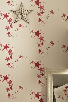 Boys and girls can dream the night away with this star wallpaper from chic design duo Barneby Gates