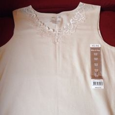 NWT Cream off white tank top New with tags, cream off white tank top, V neck covered in lace, size small 4-6, brand White Stag White Stag Tops Tank Tops