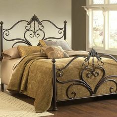 Scrolling metal bed with ball finials.  Product: BedConstruction Material: MetalColor: Antique b...