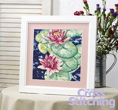 A picture of elegant serenity, in a water lily cross stitch scene by @Katie Schmeltzer Schmeltzer Knight for The World of Cross Stitching. Find the pattern in issue 203