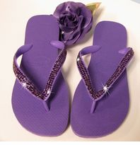 I am also thinking about flip flops.. I like the idea of glueing something pretty to them to make them more than just regular flip flops