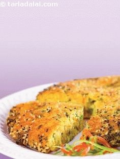 Mixed vegetable handvo, i made this instantly using fermented khatta dhokla batter; in fact any leftover batter can be used to make this handvo!  i have added lots of vegetables as it tastes amazing this way. It is an ideal low-calorie, wholesome meal. Some like it with chutney and some along with tea. Try it once and i am sure it will become one of your favourite snacks.