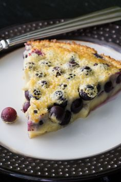 Clafoutis Blueberry clafoutis is a classic French dessert made by baking blueberries in a custard. This simple blueberry clafoutis recipe is easy to make. via sponsored by Fresh from FloridaBlueberry clafoutis is a classic French dessert Profiteroles, Croissants, Blueberry Clafoutis, Blueberry Custard Pie, Classic French Desserts, French Dessert Recipes, French Recipes, Clafoutis Recipes, Desserts Français