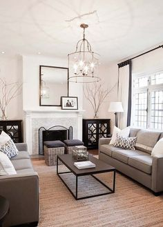 inspiring neutral living room designs I like  the small ottomans in front of fireplace