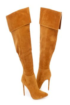 These sexy and stylish single sole high heel boots are a must have this season! The features include a faux suede upper with a pointed closed toe, cuffed top, inner side zipper closure, smooth lining, and cushioned footbed. Approximately 4 1/2 inch heels, 16 1/2 inch circumference, and 18 inch shaft.