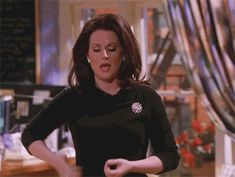 Pin for Later: 40+ Karen Walker GIFs That Prove She Deserves Her Own Holiday When She Readies Her Most Valuable Weapons
