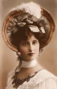 Hand colored photo of Gorgeous turn of the century young woman.