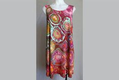 $50 - Tie dye tunic sleeveless top  ice dye festival boho indie Find this item on https://www.etsy.com/shop/ASPOONFULOFCOLORS?ref=hdr_shop_menu