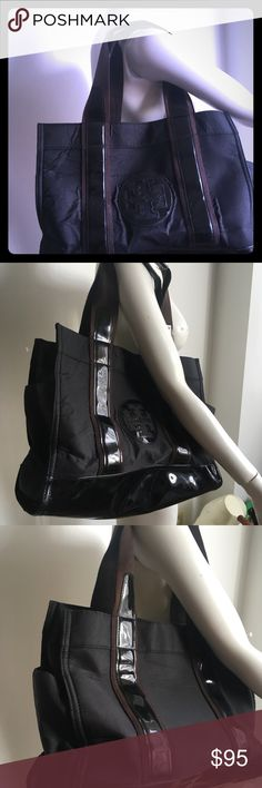 Troy  Burch tote Black Pre owned in okay condition minor shown of worn  see few scratches and  two rips on  the handle sold as is see all photos for details has bubbles on the front  sold as is troy burch Bags Totes