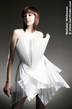 awesome architectural origami dress. cute haircut too.