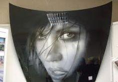 2. Hoodlums- Airbrushed art on car hoods