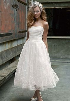 I know its strapless and short, but I LOVE this!!! David's Bridal, Alina Style WG 3606 $499
