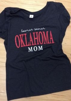 Let your Sooners support show with this Oklahoma Sooners Womens Red Emily Short Sleeve T-Shirt! Rally House has a great selection of new and exclusive Oklahoma Sooners t-shirts, hats, gifts and apparel, in-store and online. Boomer Sooner, Oklahoma Sooners, Lady In Red, Short Sleeves, V Neck, Sweatshirts, T Shirt, Tops, Women