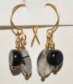 "Tourmalinated Quartz & Jet Earrings on Brass Wire & Brass Fish Hooks - $9 in my ETSY shop: www.ETSY.com/shop/harperscauldron.  Tourmalinated Quartz combines the qualities of quartz and tourmaline - it appears as a clear crystal with ""threads"" of black tourmaline throughout. It is helpful for releasing tension, and is a good grounding stone.  Jet is a black stone, which is actually fossilized wood. It protects against illness and violence, and is associated with the root chakra."