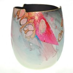 "Contemporary ceramic vase, abstract 7 3/4""  	      	                  Stylish contemporary vase decorated with colorful, abstract flowers. The bottom is incised ""Prigo."""