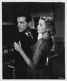 DIAL 'M' FOR MURDER (1954) - Shot in 3-D - Robert Cummings & Grace Kelly - Directed by Alfred Hitchcock - Warner Bros. - Publicity Still.