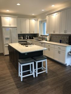 Painted white kitchen in Dartmouth door style from the Wolf Classic Line. Mixing it up with a Dark Grey stain to set this off. Kitchen Cabinets Showroom, Kitchen Cabinets In Bathroom, Kitchen Layout, Kitchen Design, Kitchen Ideas, Classic Cabinets, Grey Stain, Kitchen Remodel, New Homes