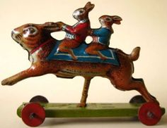 Meier Tin-Penny Toy Rabbit riding rabbit, lithographed on wheeled bas