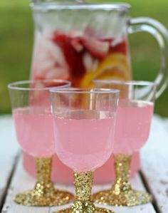 Instead of buying boring cups, try making these glitter party cups! All you need is plastic cups with a stem, glitter, glue, and a creative mind! For a pink drink, you can use pink lemonade. If you want to get creative, you can always make lavender lemonade for a purple tint!