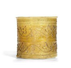 A Roman amber glass Harvest beaker, circa 1st century A.D.