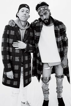 Jerry Lorenzo wearing Fear of God Selvedge Denim Vintage Indigo Jeans, Fear of God The Plaid Overcoat, Fear of God Fourth Collection Inside/Out T-Shirt
