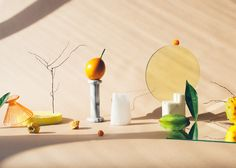 A series of still life images titled 'Arrangements' by Melissa Gamache that explore the use of everyday objects, fruits and vegetables.