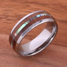 Koa Wood Abalone Tungsten Two Tone Wedding Ring Central Abalone 8mm Item Number:TUR4024 Band Width:8mm Material: Tungsten, Koa Wood, Mother of Pearl Available Size(US):size 6 up to size 14 included ha