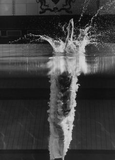 Photo by George Silk - 14 yr old diver Kathy Flicker's perfect 10 point entry into the waters of a pool at Princeton University's Dillion Gym, USA. 1962. S)