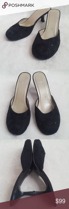 """Splash Shimmer Sparkle Slides Heels Splash slides or open heels with 2 1/2"""" kitten heel. Otnated stitched detail & design with subtle shimmer sparkle. Each tiny dot will shimmer & shine based on lighting. Rounded toe.   Excellent used condition. Smoke free and pet free home.   Check out my other listings - 100's of 👠shoes👠, 👢boots👢 and 👜bags👜. Bundle 2 or more and save money!💲💰💲 Splash Shoes Heels"""