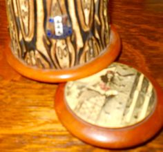 A close up of the unusual wood that makes up this inkwell along with the town of Rotorua's shield._Judith Walker's Collection