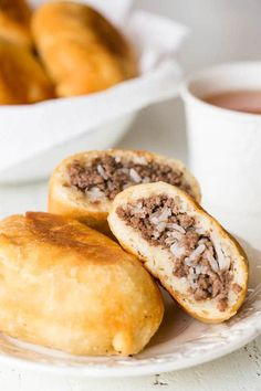 Sharing my mom's secret to the softest and fluffiest piroshki (Russian hand pies) with simple beef and rice filling. But you can customize the filling however you like!