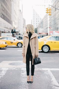 Go for a sophisticated look in a tan coat and black leather fitted pants. Finish off your look with black leather pumps.
