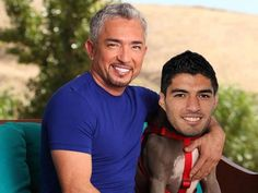 """Cesar Millan with his latest project..Luis Suarez of FC Liverpool, the biting pittbull. """" I train people and I rehabilitate dogs..."""" according Cesar's own slogan"""