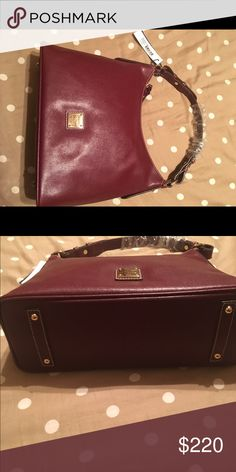 Dooney & Bourke authentic hobo satchel Bordeaux!  Absolutely GORGEOUS authentic Dooney & Bourke hobo satchel in a unique Bordeaux color!! Brand new with original tags!! Still in original packaging! Bag has gold feet on bottom & zipper pocket inside. Also with two snap slots inside for cell phone holder or other safe keep items! Bag measures at 13inches across and 10inches in height. Dust bag included!!  Dooney & Bourke Bags Satchels