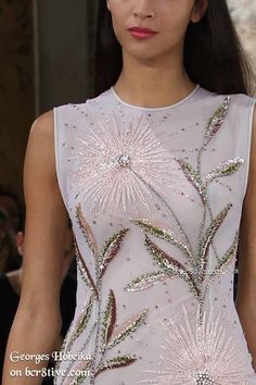 Georges Hobeika designed an embroidered beading tribute to the way Nature regenerates and bursts through winter with new growth and life.