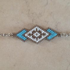 Bracelet peyote in MIYUKI pearls - Ideas & Thoughts Bead Loom Bracelets, Peyote Beading, Bracelets Design, Handmade Bracelets, Bracelets For Men, Bracelet Men, Seed Bead Jewelry, Bead Jewellery, Tutorials
