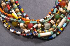 9 Strands of Color – stones glass + bones
