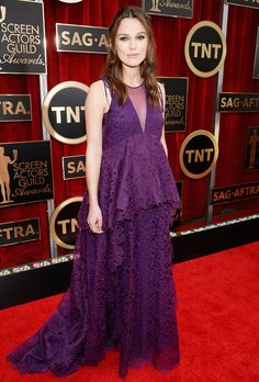 Pregnant Keira Knightley turned heads in a voluminous purple lace Erdem gown at the 2015 SAG Awards on Jan. 25, where she walked the red carpet with husband James Righton -- see her baby bump!