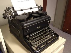 Upon the desk is a Royal typewriter, originally from the USA.