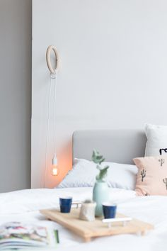 Not only will you brighten up your bedroom decor with a DIY gym ring hanging pendant lamp, but it might even help you with your resolutions!