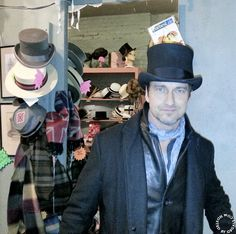 Gerard Butler visits The Village Scandal in NYC, his favorite hat store